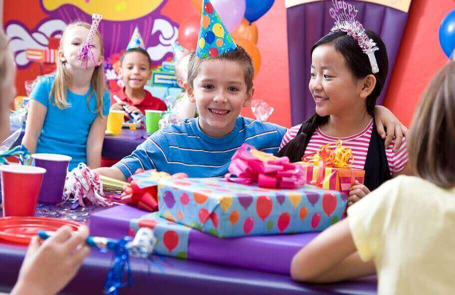 Boy and girl celebrating birthday with presents.