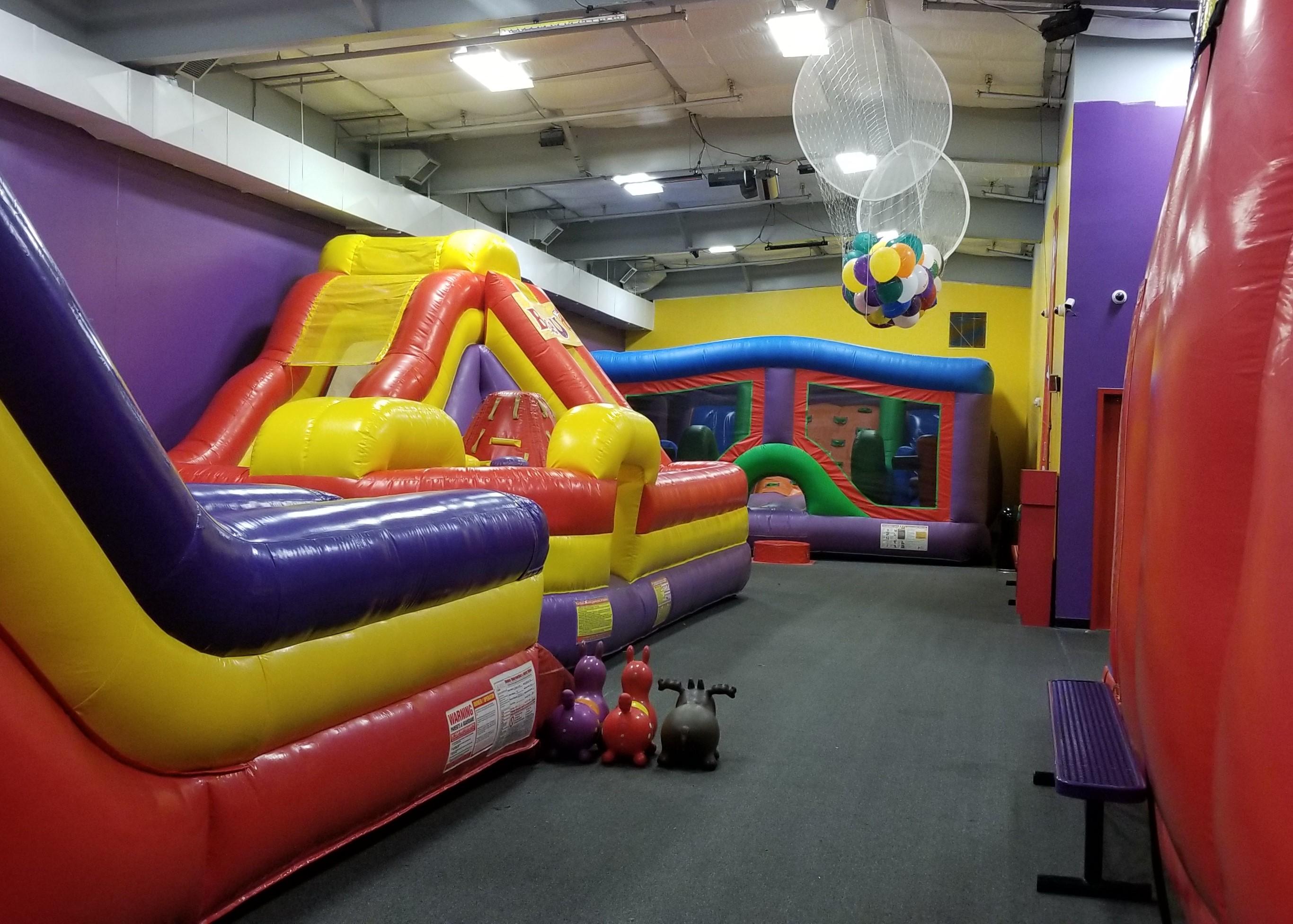 Giant inflatables in BounceU Rockville's indoor arenas.