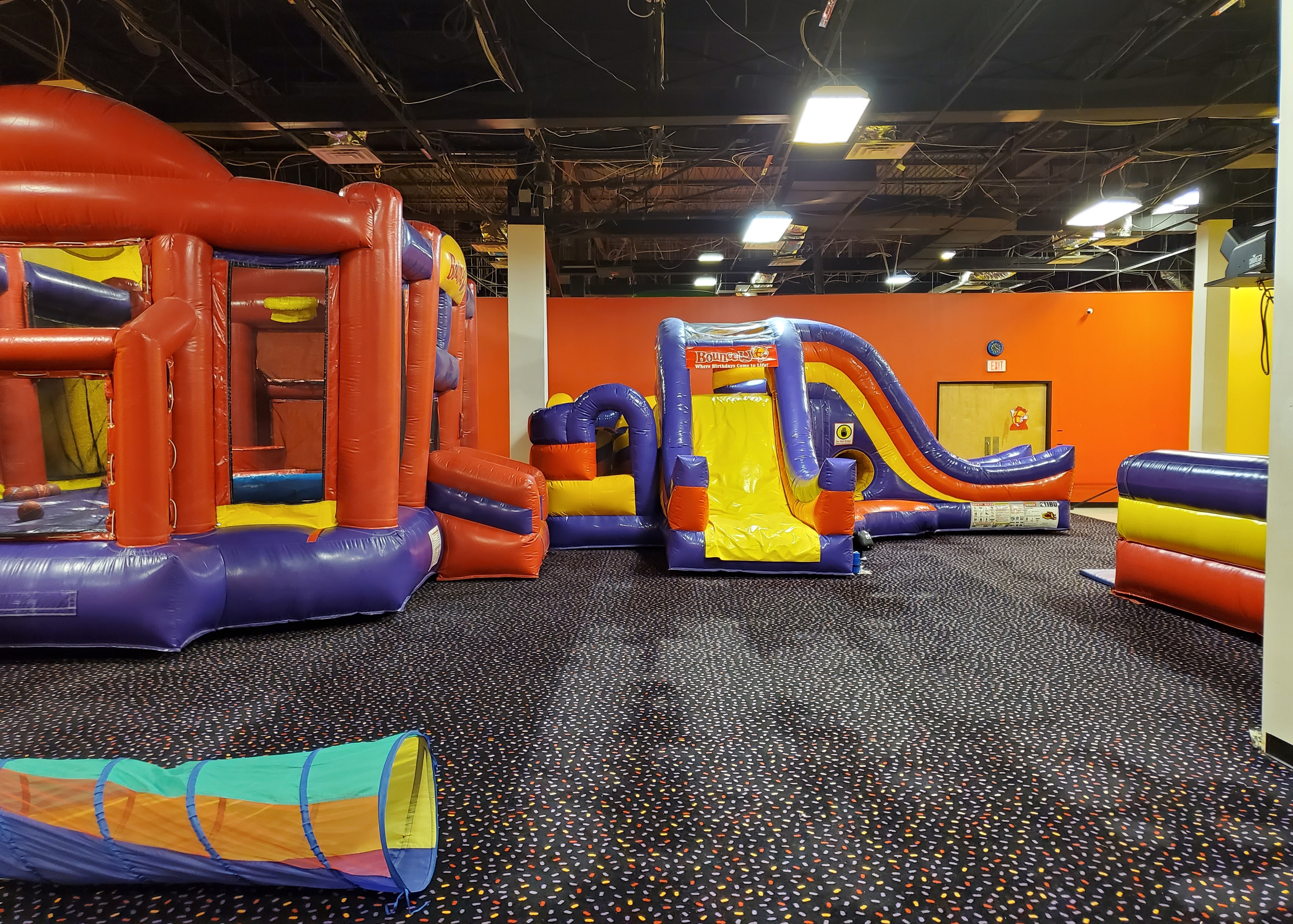 BounceU birthday party arena space with two large inflatable rides for private parties.