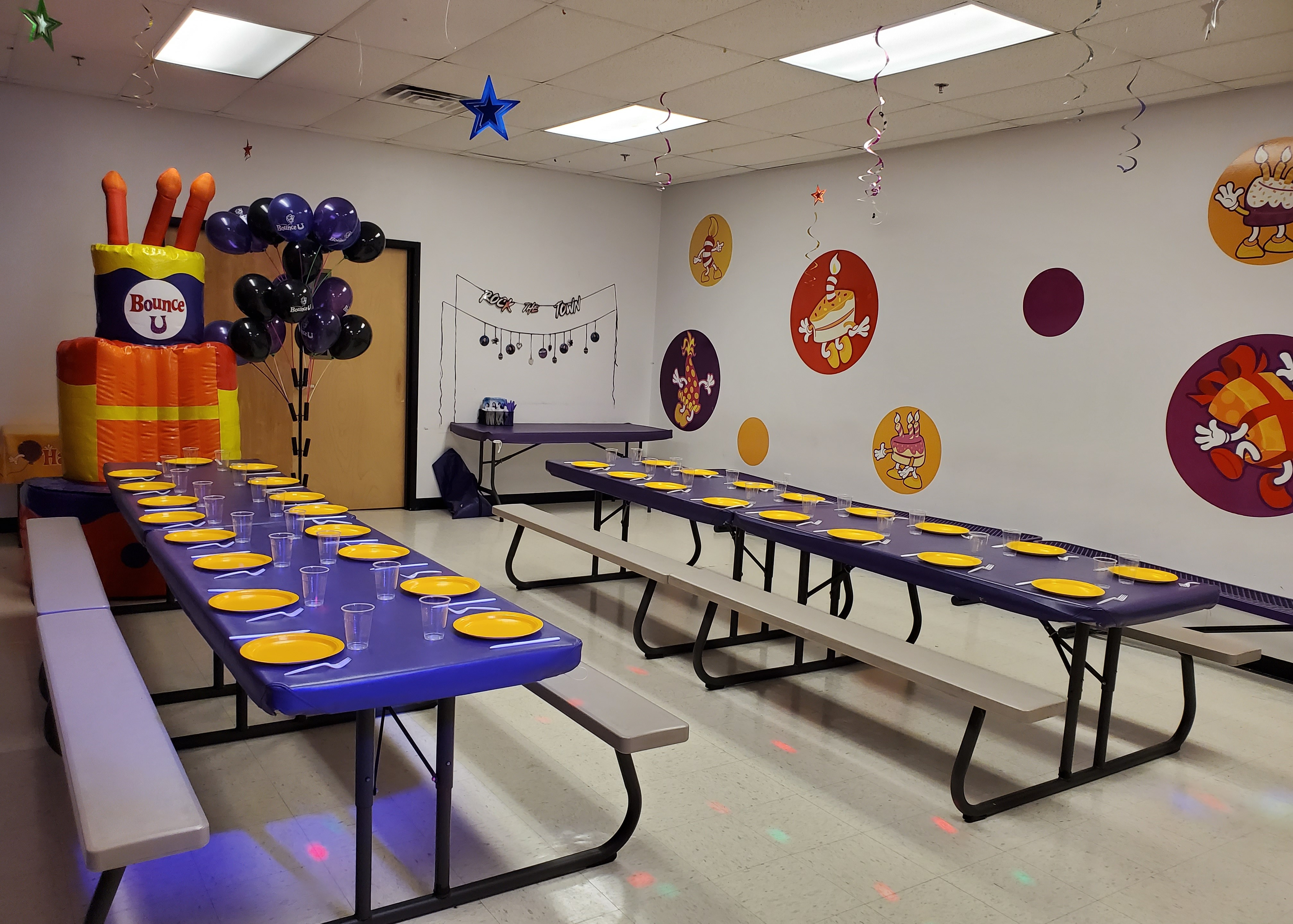 BounceU birthday party room with tables and birthday throne for private parties.
